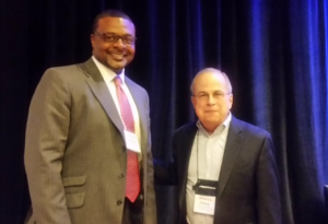 USA Funds' Lorenzo Esters with George Mehaffy, AASCU's vice president for academic affairs, after the presentation of the USA Funds RFY grant, at a meeting of chief academic officers at AASCU member schools, on July 23, 2015, in Portland, Ore.