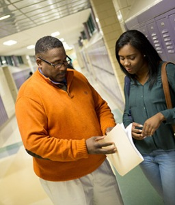 As a high school senior in Delaware, KaSaundra Kane, right, from the JAG class of 2015, received support from JAG staff including Randy Holmes.
